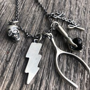 """Coach """"Found Objects"""" SKULL long charm necklace"""
